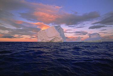 Iceberg drifting in Labrador Sea current under early evening skies, summer season, Labrador, Newfoundland, Canada  -  Yva Momatiuk & John Eastcott