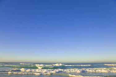 Gentle sea waves rolling on sandy St. Kilda Beach in soft morning light, winter, Dunedin, Otago, South Island, New Zealand  -  Yva Momatiuk & John Eastcott