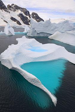 Emerald pool in iceberg, stranded in shallow bay near Booth Island, Antarctica  -  Yva Momatiuk & John Eastcott