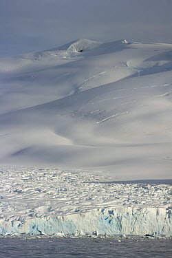 Coastal glacier descending to sea, Grandidier Passage, western Antarctica  -  Yva Momatiuk & John Eastcott