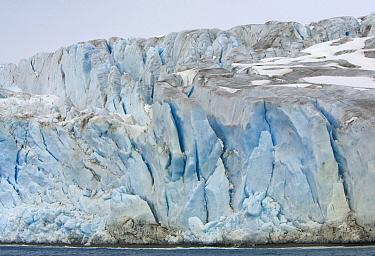 Crumbling blocks of ice of blue Fortuna Glacier descending to sea near Fortuna Bay, South Georgia Island  -  Yva Momatiuk & John Eastcott