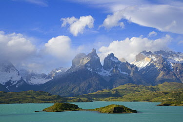 Cuernos del Paine peaks in morning light covered with cumulus clouds, Torres del Paine National Park, Patagonia, Chile  -  Yva Momatiuk & John Eastcott