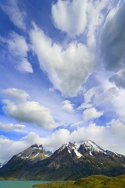 Cuernos del Paine peaks in dramatic morning light covered with cumulus clouds, Torres del Paine National Park, Patagonia, Chile  -  Yva Momatiuk & John Eastcott