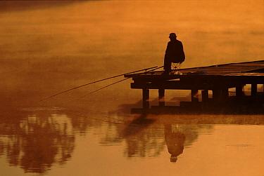 Angler, fishing at sunset, Poleski National Park, Poland  -  Artur Tabor/ npl