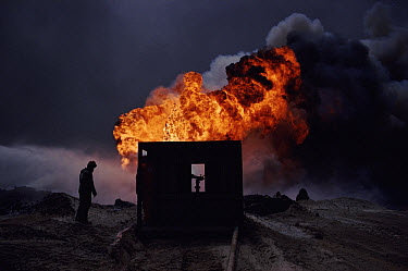 Burning oil well with water control from heat-shielding shed (post Gulf war), Kuwait  -  Ross Couper-Johnston/ npl