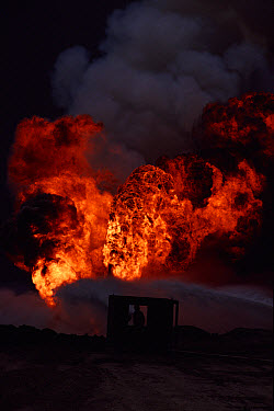 Burning oil well with water control from heat-shielding shed, (post Gulf war), Kuwait  -  Ross Couper-Johnston/ npl