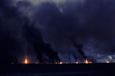Burning oil wells, after Gulf War, Kuwait  -  Ross Couper-Johnston/ npl