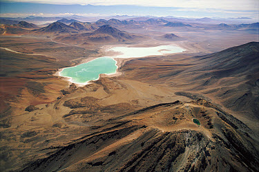Laguna Verde, an alkaline lake at the foot of the extinct volcano Licancabur. Water is colored by copper mineral sediment, Andes, Bolivia at 4500 meters elevation  -  Doug Allan/ npl