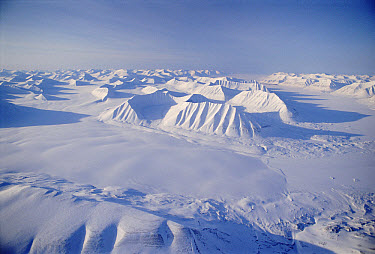 Aerial of frozen peaks and sea ice in winter, Svalbard, Norway  -  Doug Allan/ npl