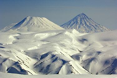 Snow-covered Kronotsky and Krasheninnikov Volcanoes, Kamchatka, Russia  -  Igor Shpilenok/ npl