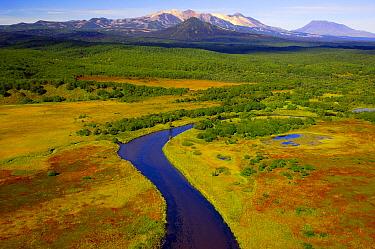 Tikhaya River flowing through the colourful tundra in autumn with Kikhpinich and Krashenninikov volcanoes in the distance, Kronotsky Zapovednik, Kamchatka, Russia  -  Igor Shpilenok/ npl