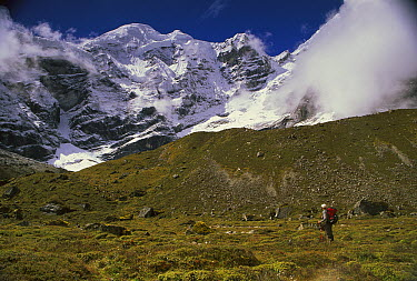 Trekker under Mera Peak, Hinku Valley, Makalu-Barun National Park, Nepal  -  Colin Monteath/ Hedgehog House