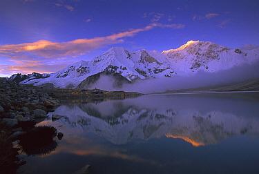 Baruntse, 7220 meters elevation, and mountaineering camp reflected in alpine lake, Makalu-Barun National Park, Nepal  -  Colin Monteath/ Hedgehog House