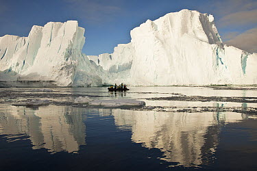 Tourists in zodiac looking at iceberg grounded off Coulman Island, Ross Sea, Antarctica  -  Colin Monteath/ Hedgehog House