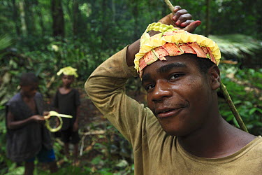 Baka boys making fiber crowns for a night ceremony, Cameroon  -  Cyril Ruoso