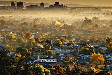 Smog from wood and coal fires blankets suburbs and city center on autumn dawn, Christchurch, Canterbury, New Zealand  -  Colin Monteath/ Hedgehog House
