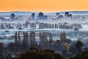 Smog and smoke from wood and coal fires at dawn blankets central city, Christchurch, Canterbury, New Zealand  -  Colin Monteath/ Hedgehog House