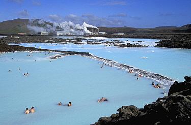 Tourists bathing in Blue Lagoon spa at forty-two degrees celcius, Svartsengi Geothermal Power Plant, Reykjanes Peninsula, Iceland  -  Christophe Courteau/ npl