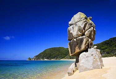 Rock on white sandy beach, Abel Tasman National Park, New Zealand  -  Stephen Belcher