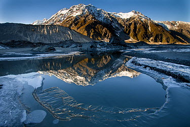 Reflection of Mount Wakefield in frozen Mueller Lake, Mount Cook National Park, New Zealand  -  Colin Monteath/ Hedgehog House
