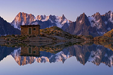 Mountain shelter at Lac Blanc with reflection of Mont Blanc, France  -  Ingo Arndt