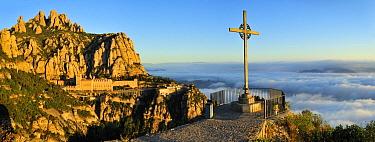 Cross on overlook with Montserrat Basilica in the background, Montserrat Natural Park, Catalonia, Barcelona, Spain  -  Albert Lleal