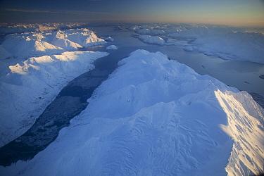 Late afternoon winter sun illuminating Mount Abdallah separating Tarr and Rendu Inlet, Glacier Bay National Park, Alaska  -  Matthias Breiter