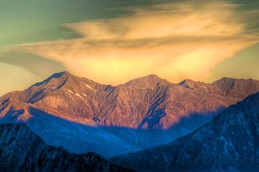 Anvil shaped cloud at sunset above Matukituki Valley, from Cascade Saddle, Mount Aspiring National Park, New Zealand  -  Colin Monteath/ Hedgehog House