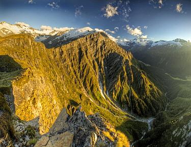 Cascade Saddle at sunrise, Mount Aspiring on right above Matukituki Valley, Mount Aspiring National Park, New Zealand  -  Colin Monteath/ Hedgehog House