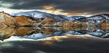 Reflections of cliffs on Blue Lake, St. Bathans, central Otago, New Zealand  -  Colin Monteath/ Hedgehog House