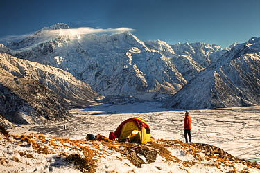 Hiker at campsite in front of Mount Sefton, Mount Cook National Park, New Zealand  -  Colin Monteath/ Hedgehog House