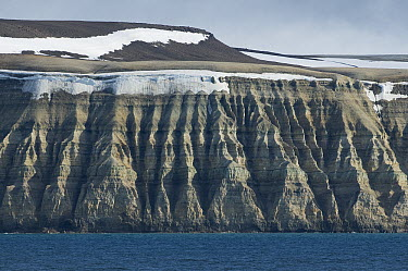 Triassic sediments eroded into cliffs, Hinlopen Strait, Svalbard, Norway  -  Kevin Schafer