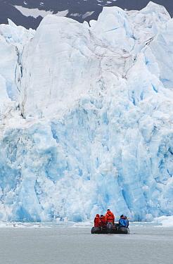 Zodiac takes travelers along glacier front, Monaco Glacier, Liefdefjorden, Svalbard, Norway  -  Kevin Schafer