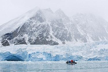 Zodiac along face of Monaco Glacier, Leifdefjorden, Svalbard, Norway  -  Kevin Schafer