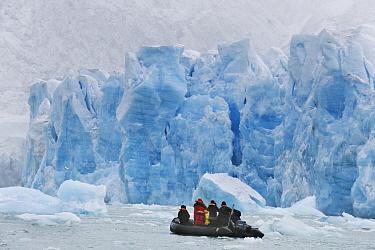 Zodiac cruises along face of Monaco Glacier, Leifdefjorden, Svalbard, Norway  -  Kevin Schafer