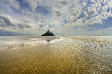 Mont Saint-Michel with waves in surrounding bay, Normandy, France  -  Jim Brandenburg