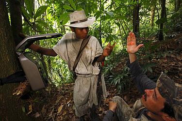 Biologist Franz Kaston Florez demonstrating how to use photo trap for tapir identification, Sierra Nevada de Santa Marta National Park, Colombia  -  Cyril Ruoso