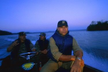 Game wardens going out on night patrol, Barro Colorado Island, Panama  -  Christian Ziegler