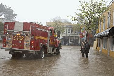 Firemen talking to shop owners during flood, Capitola, Monterey Bay, California  -  Sebastian Kennerknecht