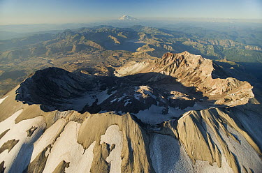 Aerial view of Mount St Helens crater with Mount Rainier behind, Mount St Helens National Volcanic Monument, Washington  -  Kevin Schafer