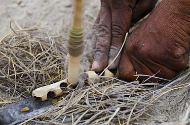Kalahari bushmen making fire, Makgadikgadi Pans, Kalahari Desert, Botswana  -  Pete Oxford