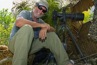 Photographer Kevin Schafer in blind, central Sulawesi, Indonesia  -  Kevin Schafer
