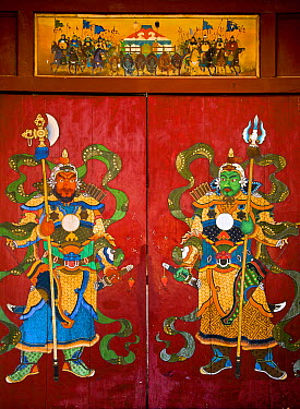 Mural of Buddhist guardians on hotel door, Ulan Baatar, Mongolia  -  Colin Monteath/ Hedgehog House