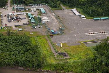 Oil installation with gas burn-off flame, Yasuni National Park, Amazon, Ecuador  -  Pete Oxford