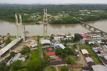 Bridge being built across Napo River to connect the town of Coca with Yasuni National Park, Amazon, Ecuador  -  Pete Oxford