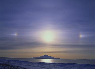 Mount Rishiri, extinct volcano with parhelion phenomenon overhead, Hokkaido, Japan  -  Masami Goto/ Nature Production