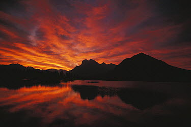Sunset behind mountains near lake, Alaska  -  Shin Yoshino/ Nature Production