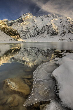 Mount Sefton and ice partially covering Mueller Lake, Mount Cook National Park, New Zealand  -  Colin Monteath/ Hedgehog House