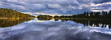 Clouds reflected in Discovery Lake, Boundary Waters Canoe Area Wilderness, Minnesota  -  Jim Brandenburg