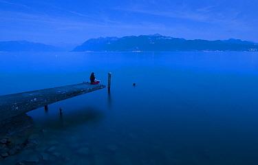 Woman on a pier at the shore of Lake Geneva, Europe  -  Rafael Rojas/ Biosphoto